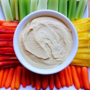 This super simple Low-Fat Hummus is so easy to make and the perfect dip for veggies or crackers! Vegan, dairy-free, gluten-free & oil-free!