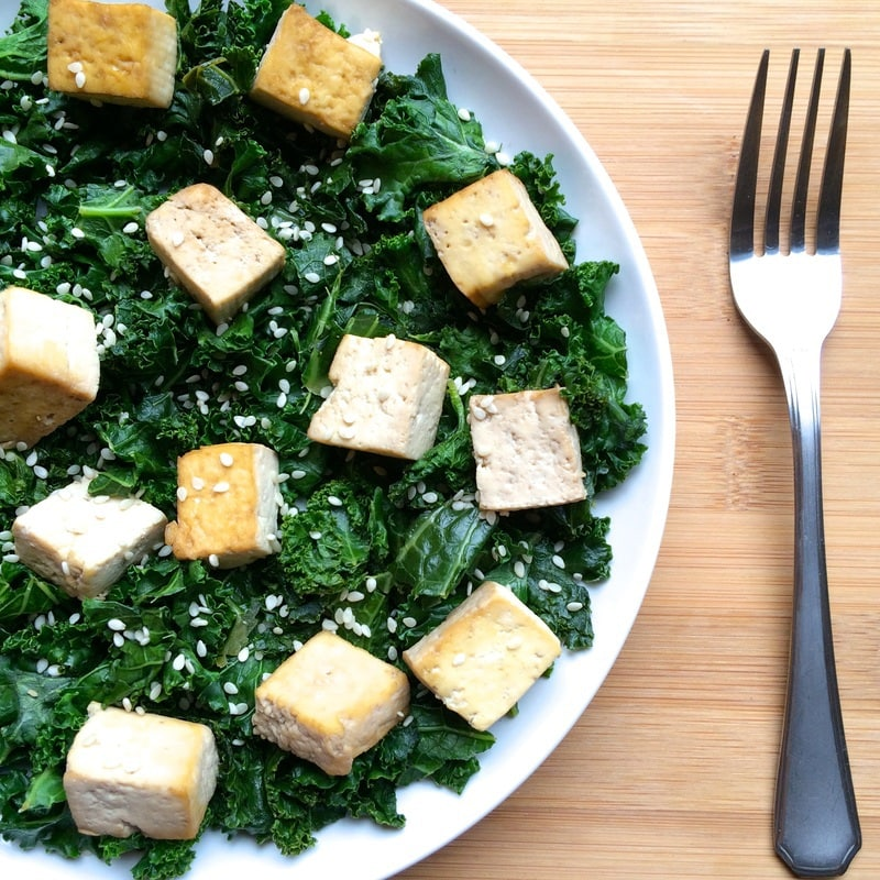 This easy Kale Tofu Stir Fry is so easy to make and a totally delicious dish that is ready in 10 minutes or less! It's packed with protein and fiber, and is the perfect vegan lunch or dinner. Gluten-free, oil-free, keto, dairy-free & low-carb, too!