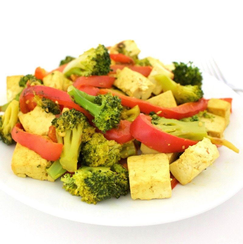 This simple Broccoli, Red Pepper & Tofu Stir Fry is AMAZING! It's the perfect, healthy vegan dinner. It's also gluten-free, dairy-free, high-protein, and super easy to make.