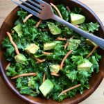 This Kale, Carrot, and Avocado Salad is light, tasty, and delicious! It is made with simple, whole food ingredients and comes together so easily. Always a crowd-pleaser! Vegan, gluten-free, paleo, and Whole 30 approved.