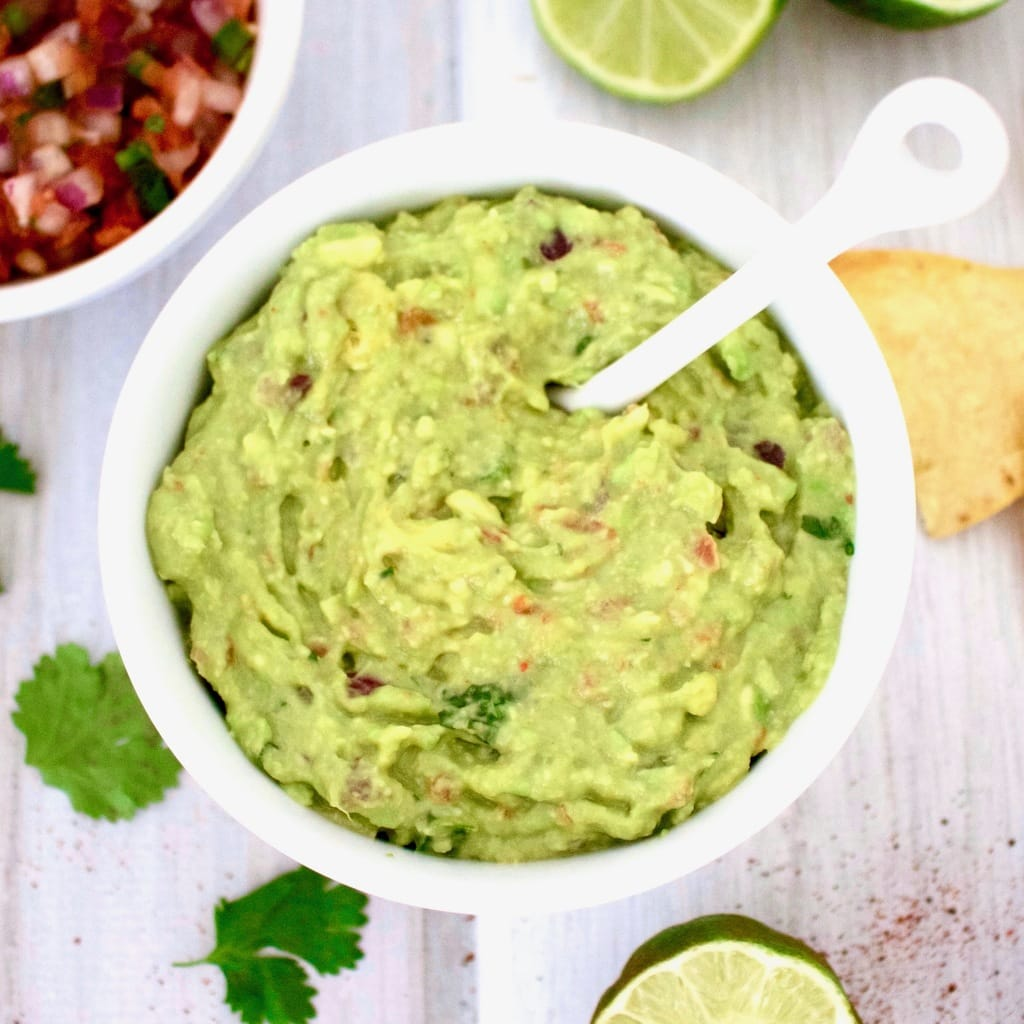 This 5-Minute Guacamole is AMAZING! The easiest recipe ever and always a crowd-pleaser. Vegan, keto, gluten-free, paleo, low-carb, oil-free & Whole 30 approved.