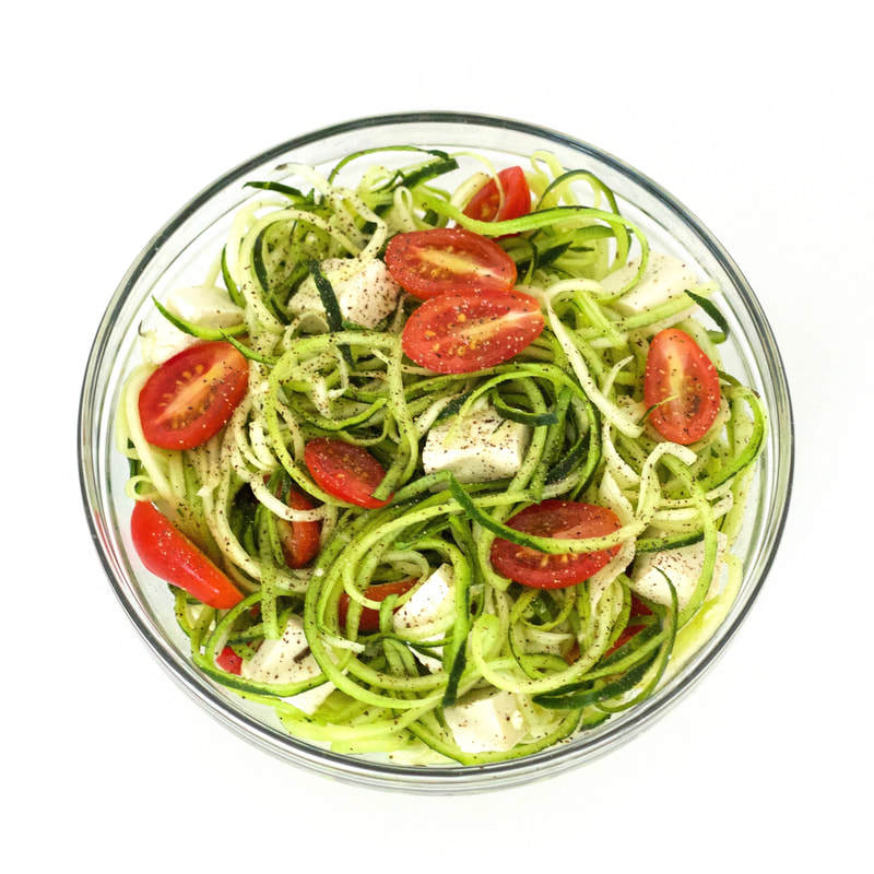 This Simple Zucchini Noodle Salad is totally delicious! Packed with with flavor and nutrition, yet super low in calories and carbs! The perfect meal for weight loss. Keto, vegan & gluten-free!