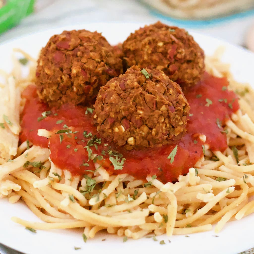 These simple Vegan Spaghetti and Meatballs are the ultimate comfort food! They are so easy to make with only 10 simple ingredients. Loaded with fiber and protein and also gluten-free, dairy-free, low-fat, and oil-free!