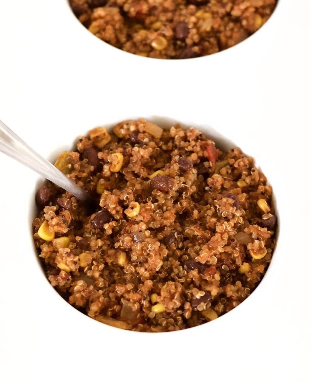 This One-Pot Quinoa Black Bean Chili is the perfect warm, cozy, and hearty meal for the holiday season! It is so easy to make - one pot and 30 minutes is all you need! This recipe is also ultra healthy and packed with nutrition - it's vegan, gluten-free, oil-free, and absolutely delicious.